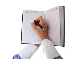 1182878_woman_writing_in_the_agenda