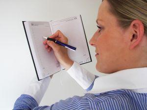 1182879_woman_writing_in_the_agenda