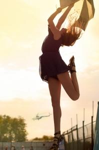 1402725_girl_dances_with_an_umbrella